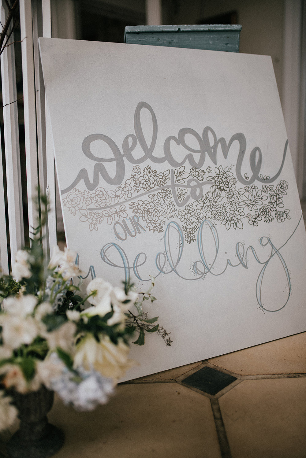 Welcome Sign Silver Calligraphy Floral Signage Blue Wedding Ideas Emma McNair Photography