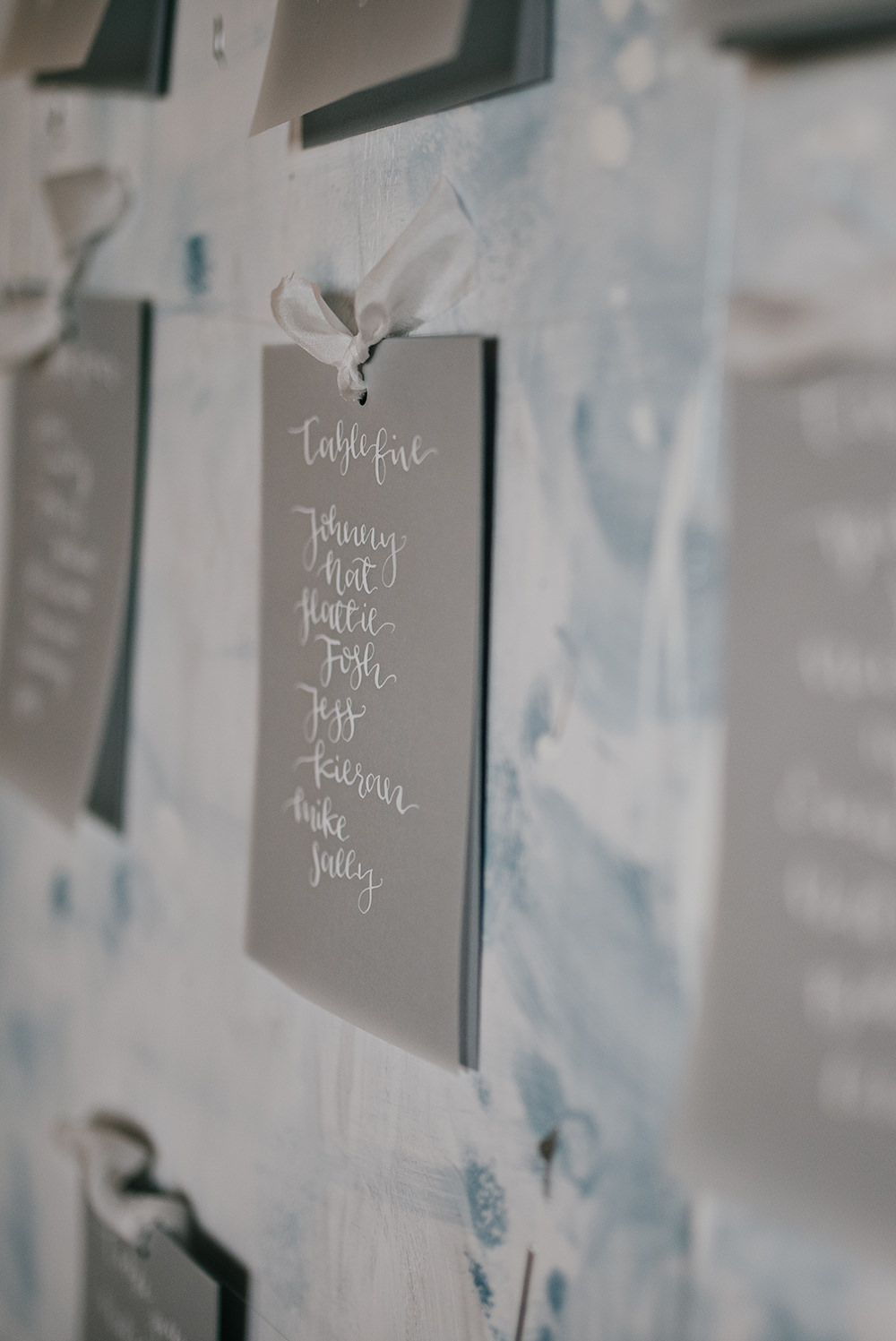 Grey White Calligraphy Seating Plan Table Chart Paint Brush Strokes Blue Wedding Ideas Emma McNair Photography