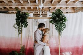 Backdrop Frame Arch Tropical Greenery Foliage Persian Rug Tie Die Fabric Botanical Industrial Wedding Caitlin and Jones Photography