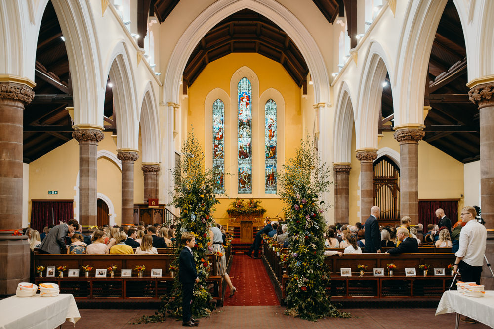 Church Flowers Aisle Pew End Installation Colourful Stretch Tent Wedding Peter Mackey Photography