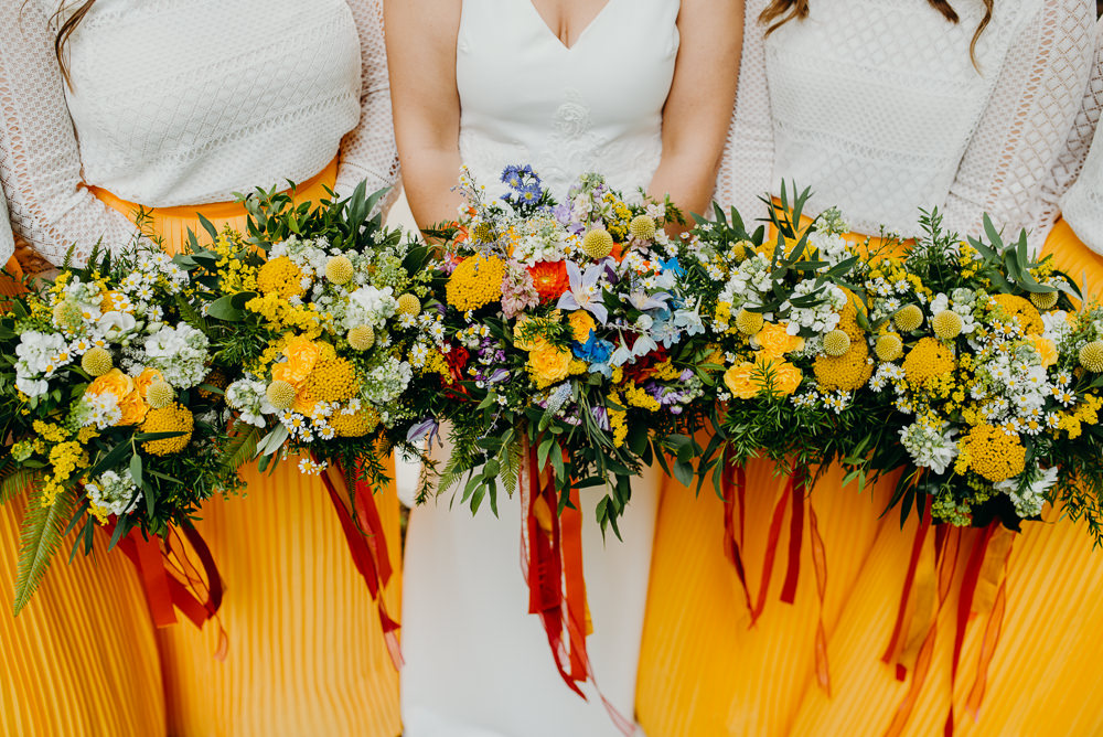 Bouquet Flowers Bride Bridal Rainbow Ribbons Wildflowers Wild Natural Bridesmaids Colourful Stretch Tent Wedding Peter Mackey Photography