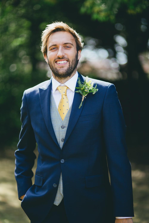Groom Groomsmen Suits Yellow Tie Navy Waistcoat Damerham Village Hall Wedding Lisa-Marie Halliday Photography