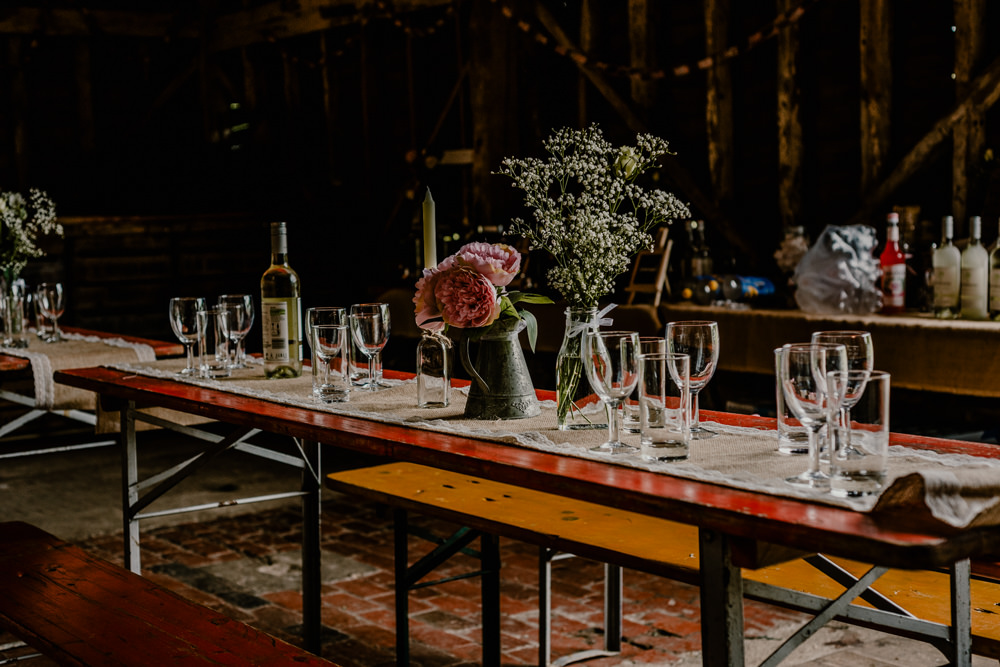Long Wooden Trestle Tables Jug Flowers Hessian Burlap Rustic Barn Wedding Louise Griffin Photography