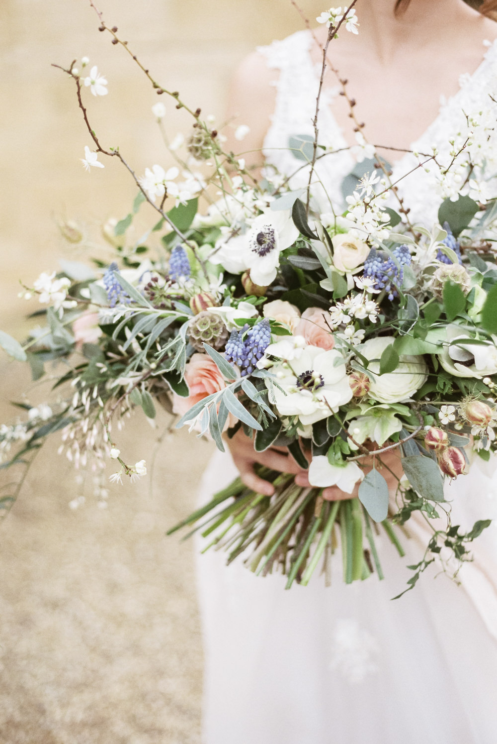 Bouquet Flowers Bride Bridal Grape Hyacinth Anemone Greenery Folliage Nigella Seeds Scabious Blossom Winter Blue Barn Wedding Ideas Joanna Briggs Photography