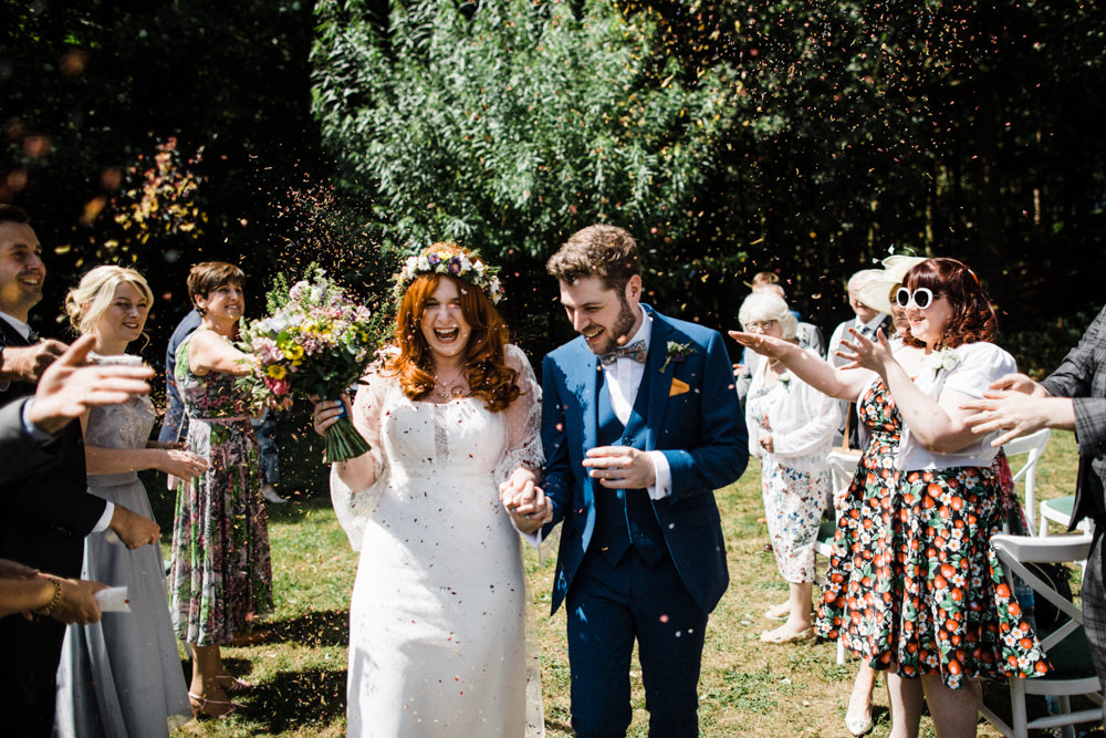 Bride Bridal Boho Cape Wedding Dress Gown Flower Crown Mrs Bow Tie Three Piece Suit Groom Confetti Wildflower Bouquet Chaucer Barn Wedding Through The Woods We Ran