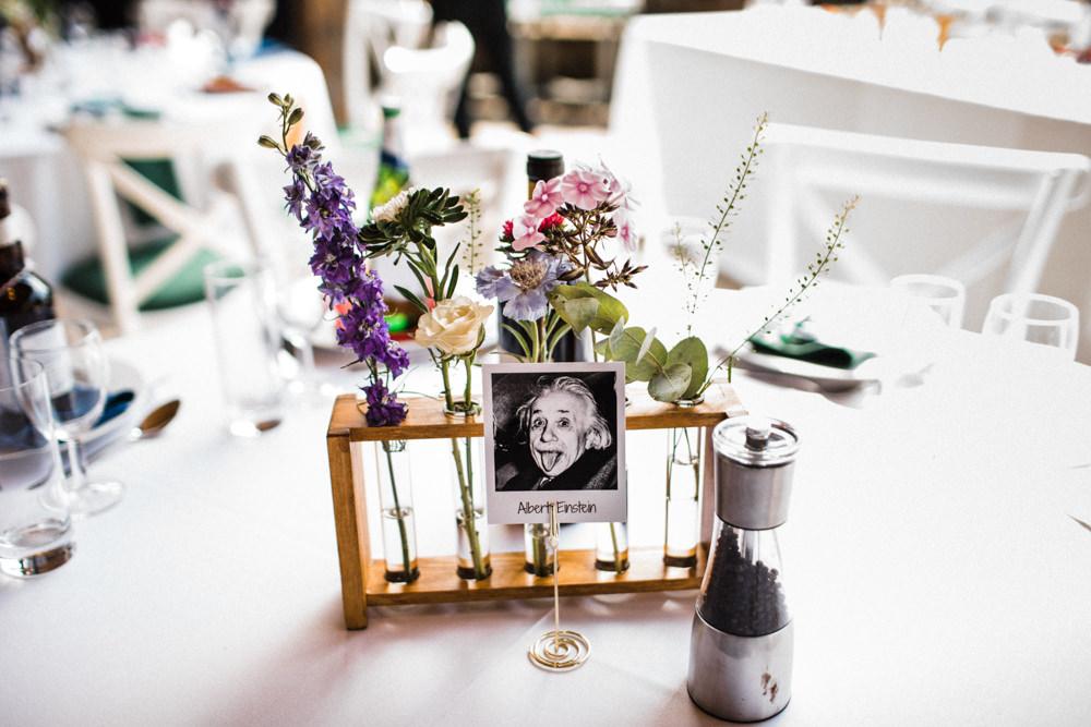 Table Name Polaroid Einstein Physicist Test Tube Holder Flowers Chaucer Barn Wedding Through The Woods We Ran