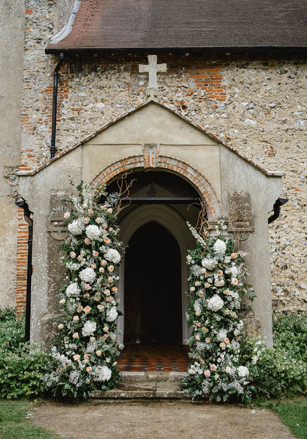 Church Flowers Arch Entrance Door Installation Backdrop Greenery Foliage Wild Natural Oxnead Hall Wedding Luis Holden Photography