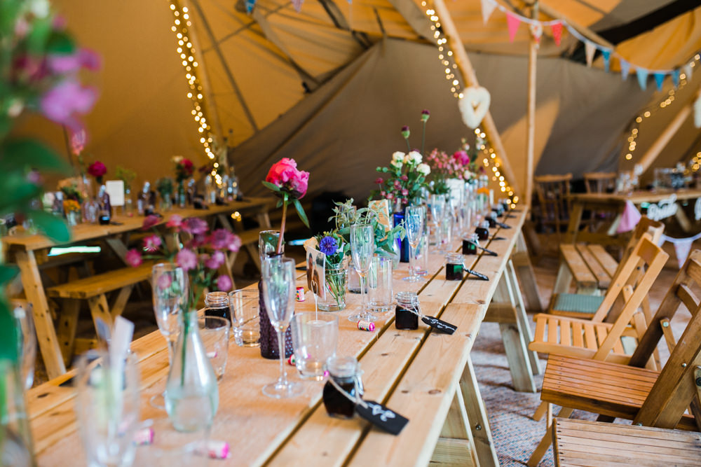 Wooden Rustic Furniture Fairy Lights Bunting Multicoloured Flowers Lincolnshire Tipi Wedding Jessy Jones Photography