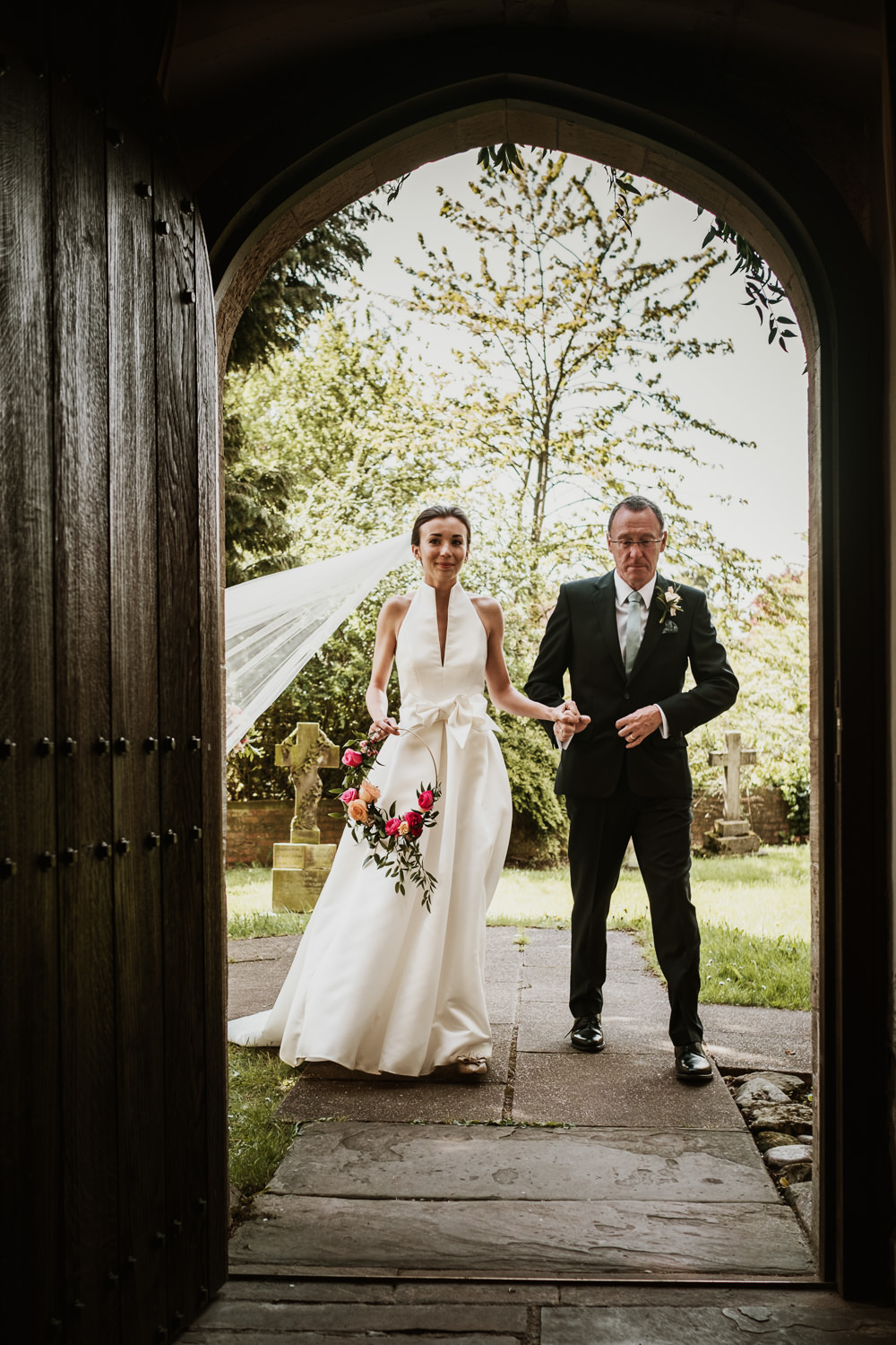 Bride Bridal Halterneck Collar Dress Gown Pockets Bow Jesus Peiro Floral Hoop Veil Middlethorpe Hall Wedding Andy Withey Photography