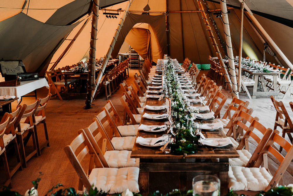 Long Wooden Tables Rustic Chairs Greenery Foliage Runner Swag Village Tipi Wedding Ryan Goold Photography