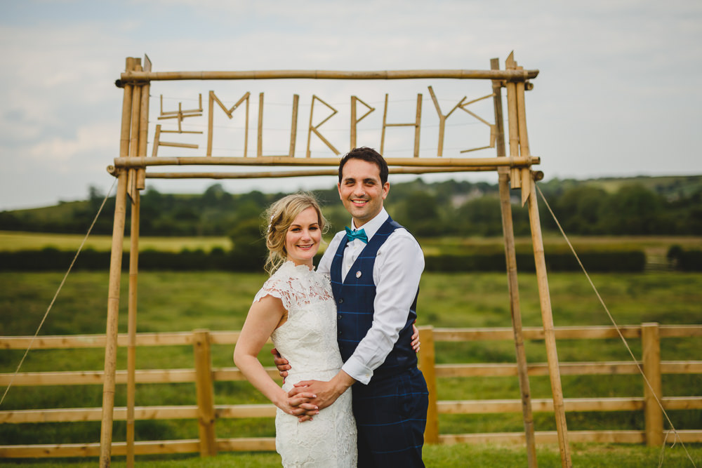 Bride Bridal High Neck Cap Sleeve Lace Fitted Dress Gown Bow Tie Waistcoat Groom Wes Anderson Camp Sign East Keswick Village Hall Wedding James & Lianne Wedding Photography