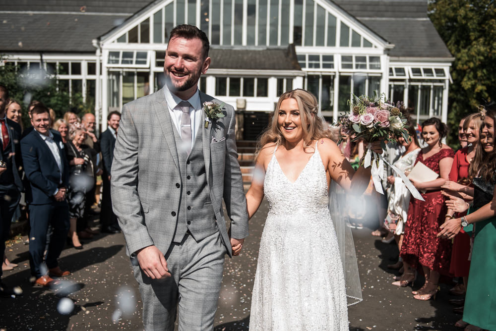 Bride Bridal Strappy Sparkly Sequin V Neck White ASOS Dress Gown Grey Checked Suit Three Piece Waistcoat Groom Bouquet Confetti Hexham Winter Gardens Wedding Leighton Bainbridge Photography