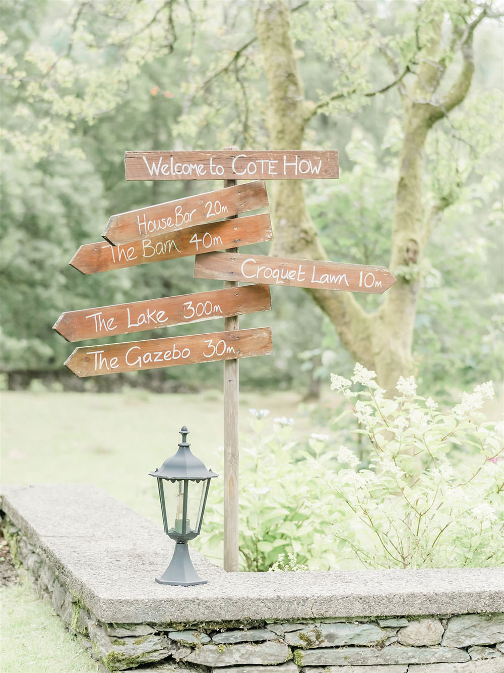 Wooden Sign Post Surprise Wedding Carn Patrick Photography