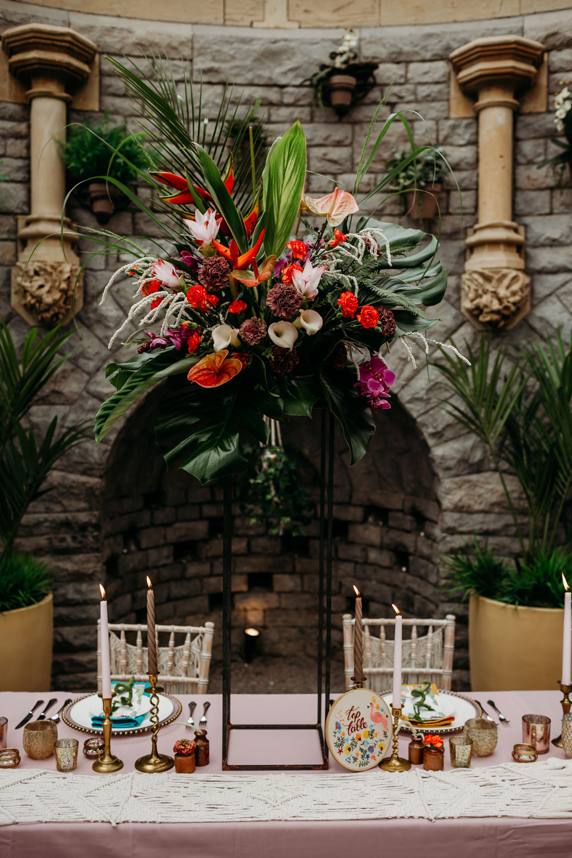 Flower Arrangement Tall Centrepiece Metal Palm Leaf Birds of Paradise Protea Hanging Orchids Anthurium Tropical Wedding Ideas When Charlie Met Hannah