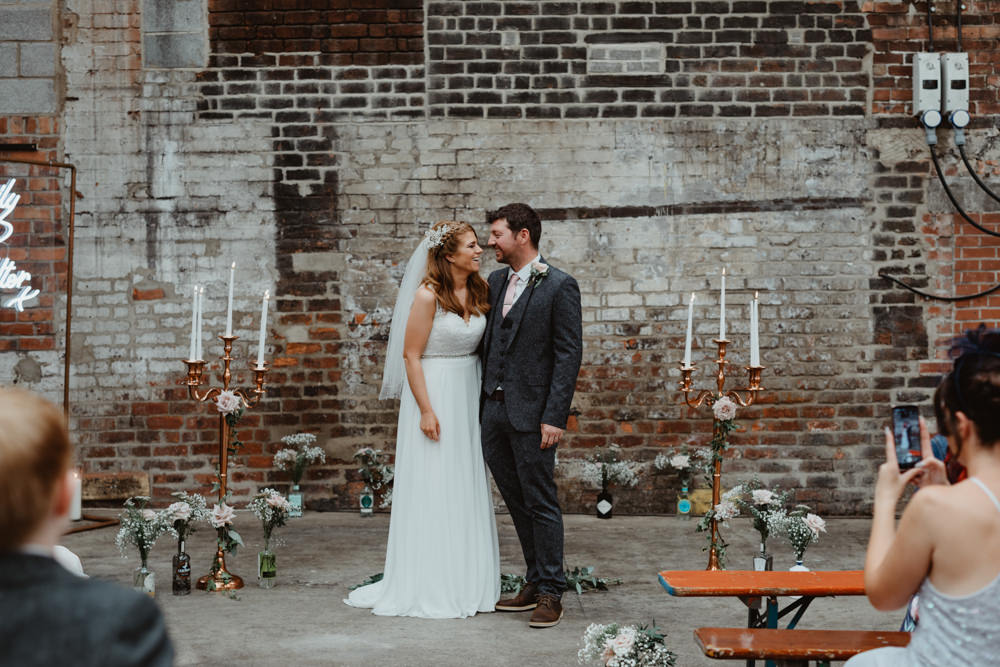 Ceremony Venue Industrial Warehouse Benches Flowers Aisle Pew End 92 Burton Road Wedding Stevie Jay Photography