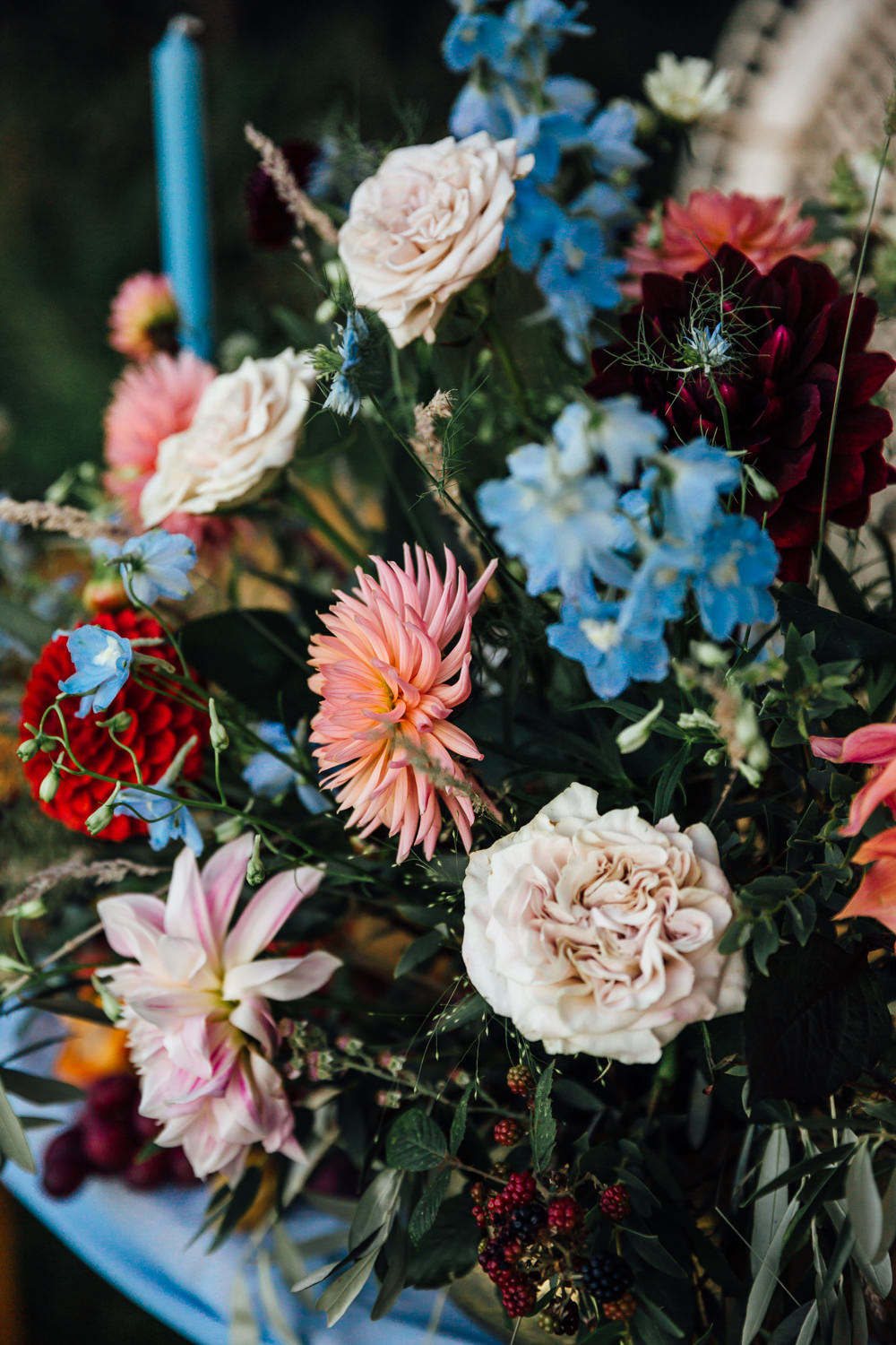 Table Flowers Centrepiece Pink Red Dahlias Blue Ribbon Delphiniums Autumn Festival Wedding Ideas Indigo and Violet Photography