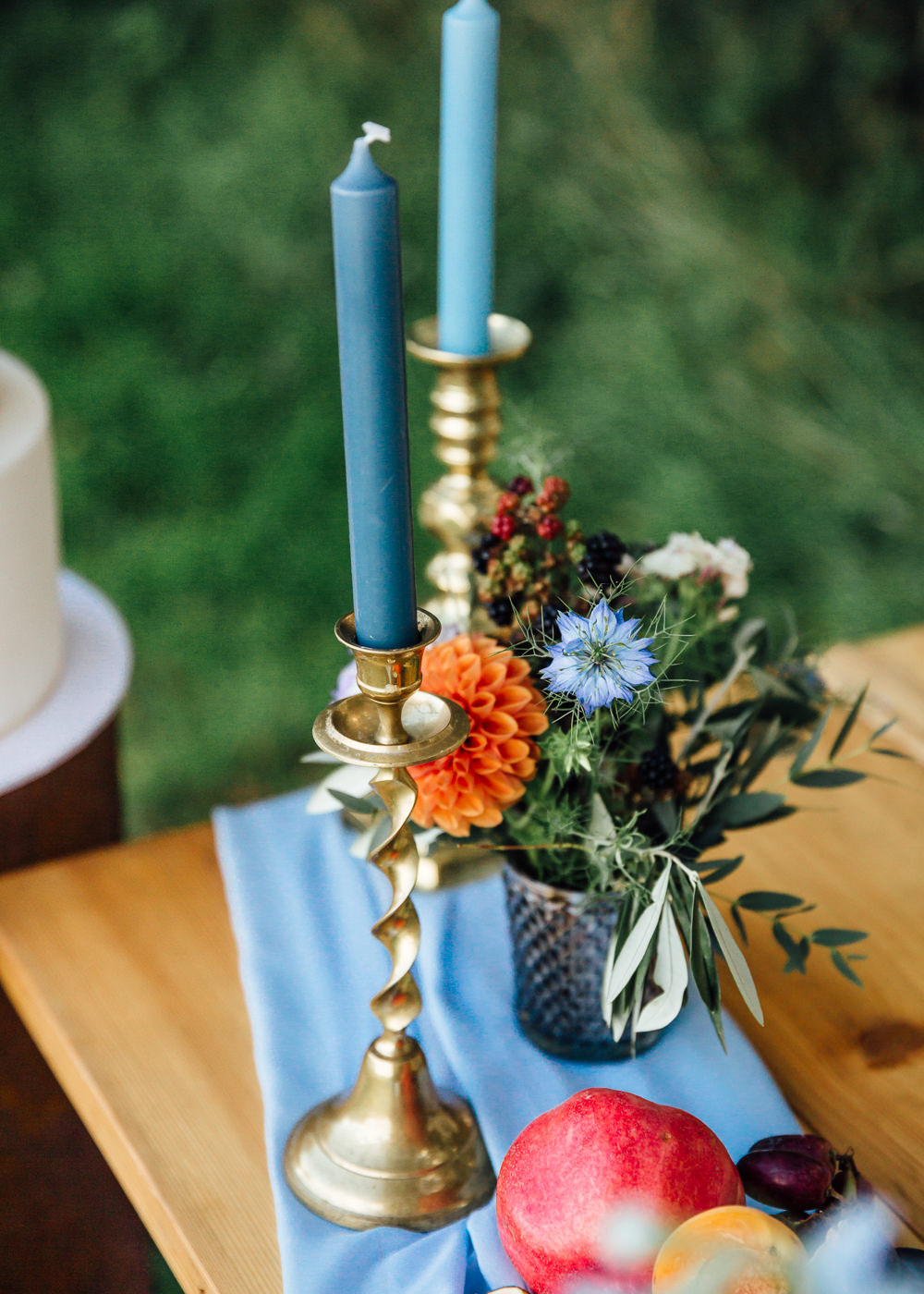 Table Flowers Centrepiece Pink Red Dahlias Blue Ribbon Delphiniums Candles Autumn Festival Wedding Ideas Indigo and Violet Photography