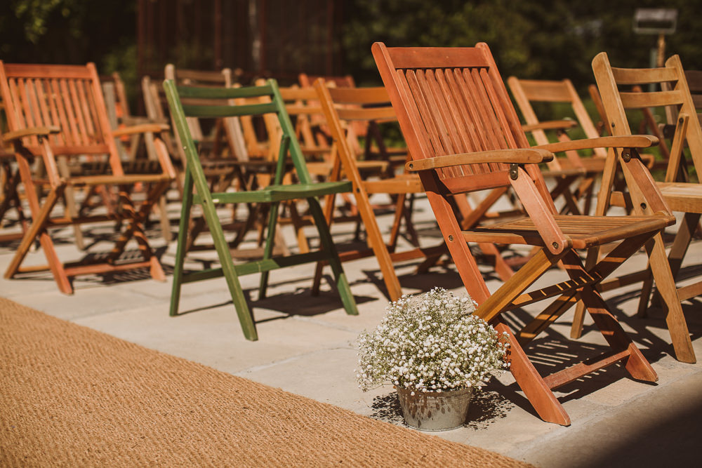 Mismatched Ceremony Chairs Outdoors Gypsophila Escape To The Chateau Wedding The Springles