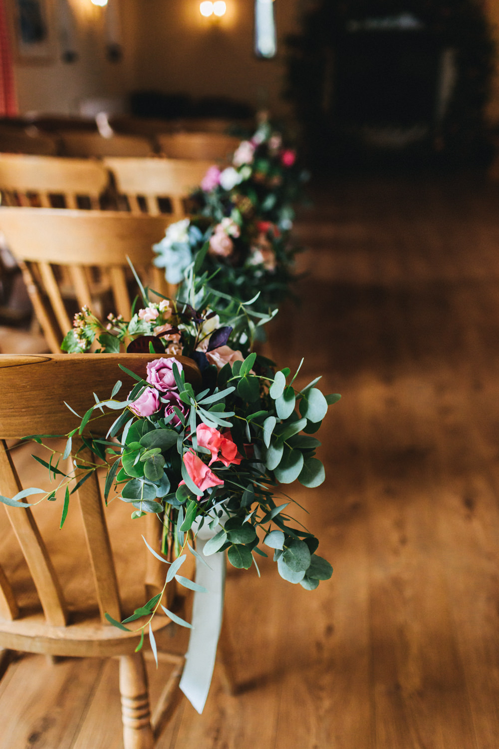 Flowers Ceremony Aisle Chairs Pew End Flowers Greenery Foliage Sweetpeas Freesias Peony Rose Burgundy Pink Outbuildings Wedding Jessica O'Shaughnessy Photography