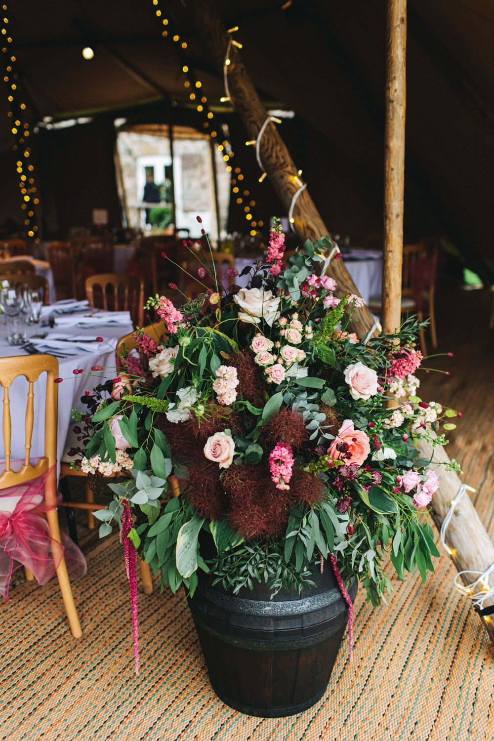 Flower Arrangement Barrel Pink Red Greenery Foliage Outbuildings Wedding Jessica O'Shaughnessy Photography
