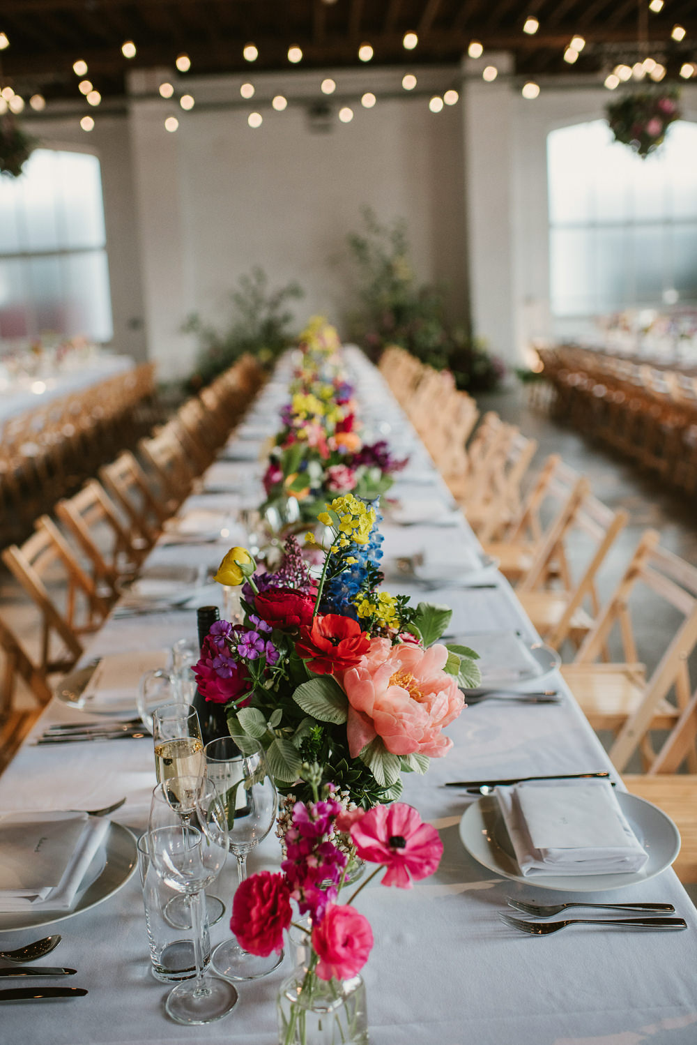 Bottle Flowers Table Decor Centrepiece Spring Coral Peony Natural Wild Colourful Long Table Riverside London Wedding Ellie Gillard Photography
