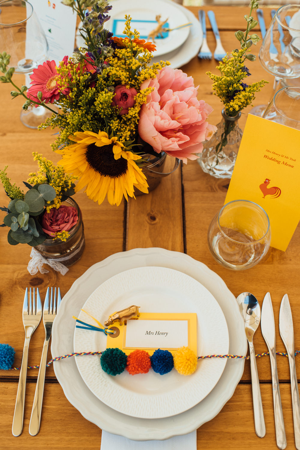 Table Decor Flowers Pom Poms Place Setting Chateau de Lacoste Wedding The Shannons Photography