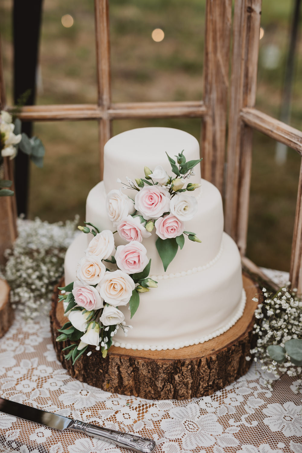 Iced Cake Sugar Flowers Log Slice Stand Clear Marquee Wedding Sarah Brookes Photography