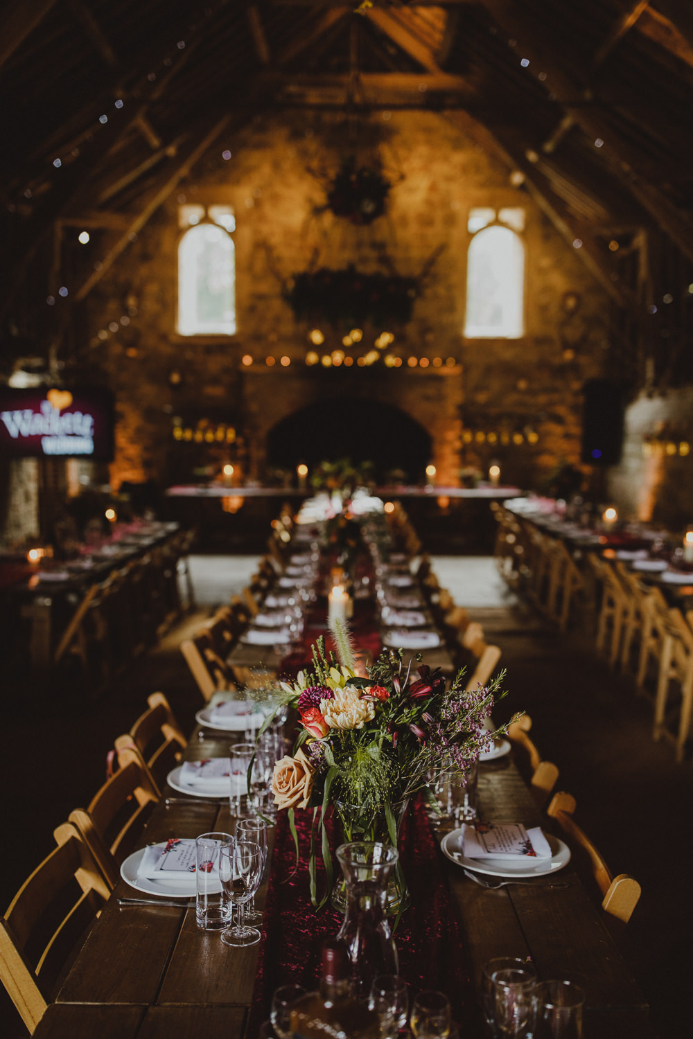 Long Tables Burgundy Table Runners Fairy Lights Flowers Wiltshire Barn Wedding Photography34