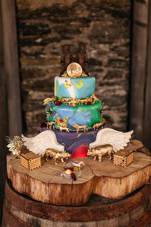 Animal Cake Wings Log Slice Stand Wonwood Barton Wedding Emma Barrow Photography