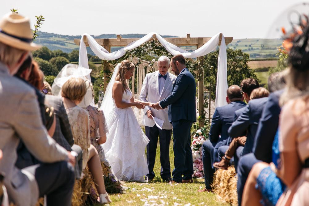 Backdrop Arch Ceremony Aisle Fabric Flowers Wonwood Barton Wedding Emma Barrow Photography