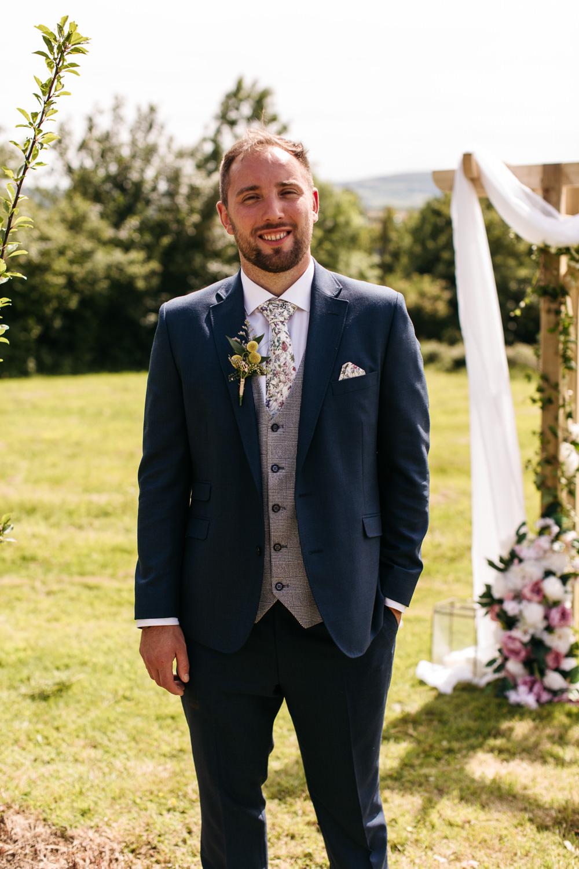 Groom Groomsmen Suit Navy Grey Waistcoat Floral Tie Wonwood Barton Wedding Emma Barrow Photography