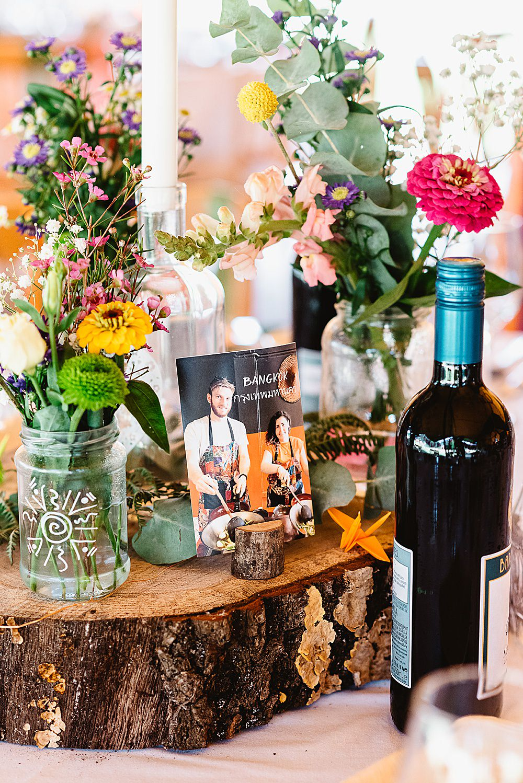 Centrepiece Log Slice Jar Flowers Colourful Wild DIY Tipi Wedding Fiona Kelly Photography