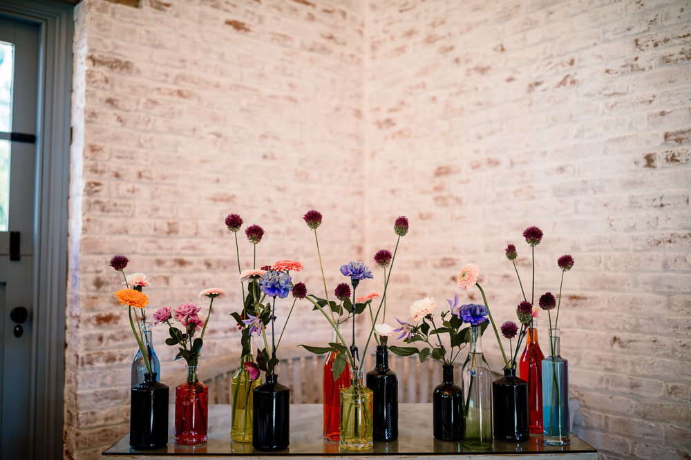Centepiece Flowers Wild Flowers Decor Table Bottles Sperry Tent Wedding Hayley Baxter Photography