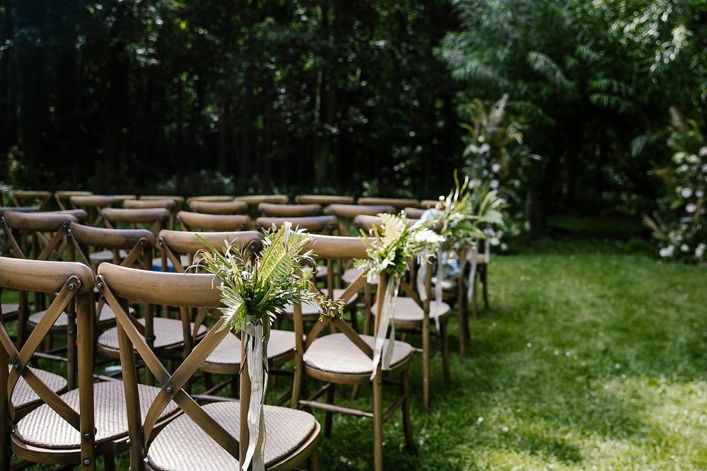 Pew End Chair Aisle Flowers Ferns Chaucer Barn Wedding Katherine Ashdown Photography