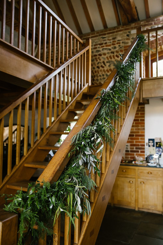 Greenery Foliage Staircase Chaucer Barn Wedding Katherine Ashdown Photography