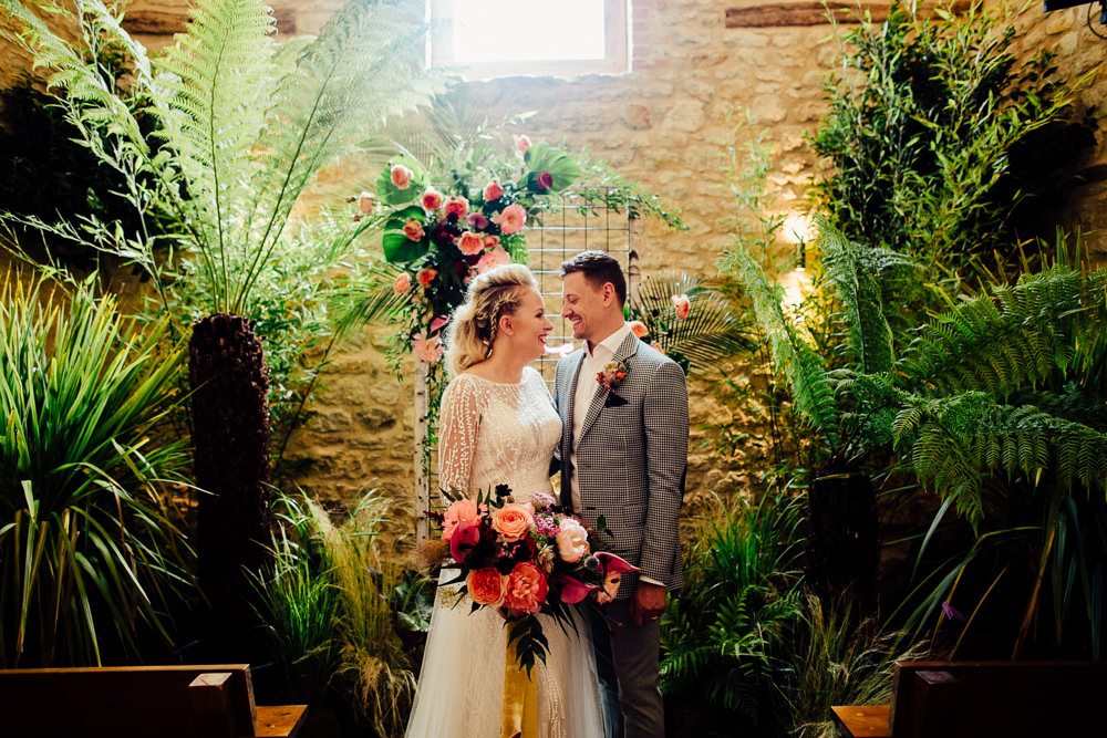 Tropical Wedding Inspiration Emily Little Photography Ceremony Backdrop Plants Greenery Foliage Neon Sign