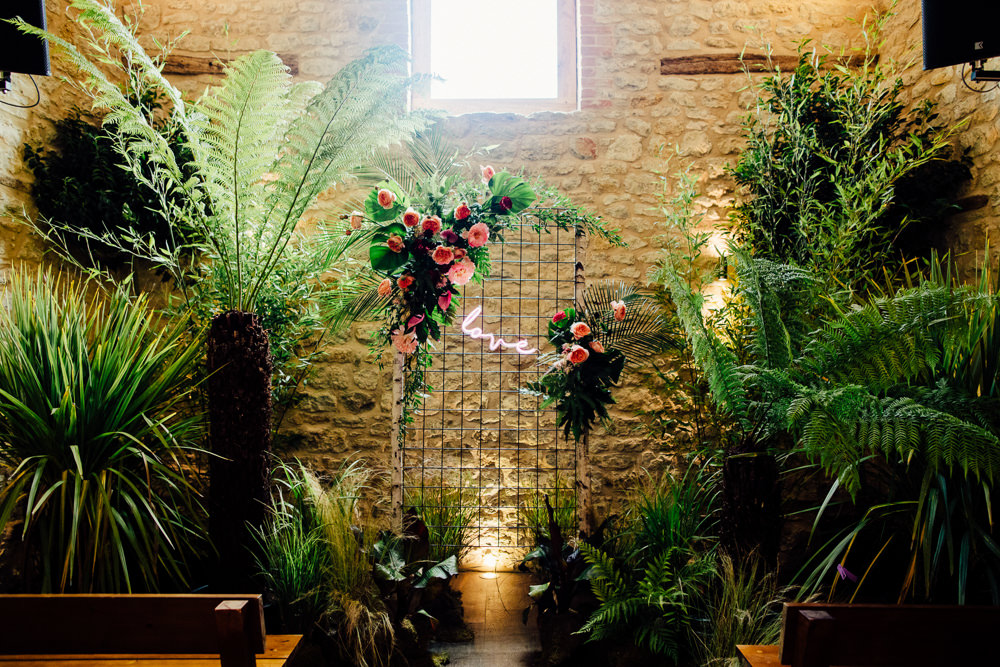 Ceremony Backdrop Plants Greenery Foliage Neon Sign Tropical Wedding Inspiration Emily Little Photography