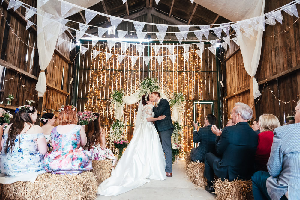 Backdrop Ceremony Fabric Flowers Arch DIY Barn Wedding Jessica Grace Photography