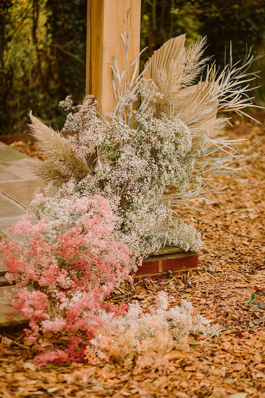 Flower Arrangement Flowers Ceremony Palms Pampas Grass Gyp Gypsophila Outdoor Autumn Wedding Ruby Walker Photography