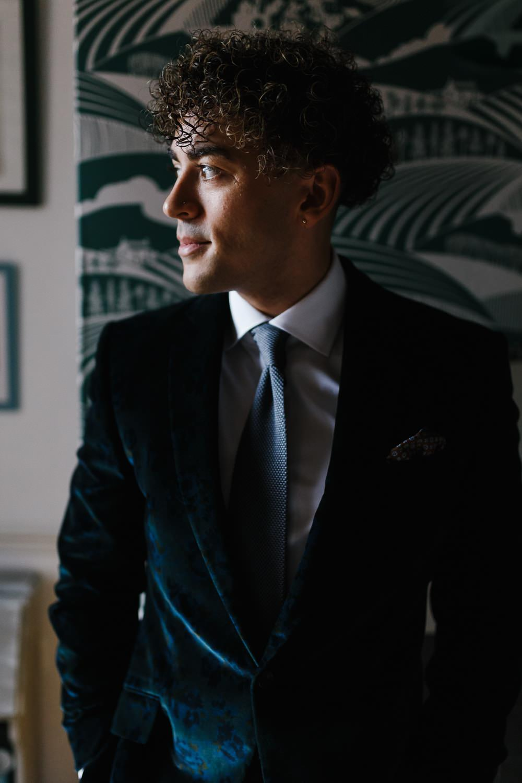 Groom Suit Green Velvet Jacket Knitted Tie Village Hall Wedding Emily + Katy Photography