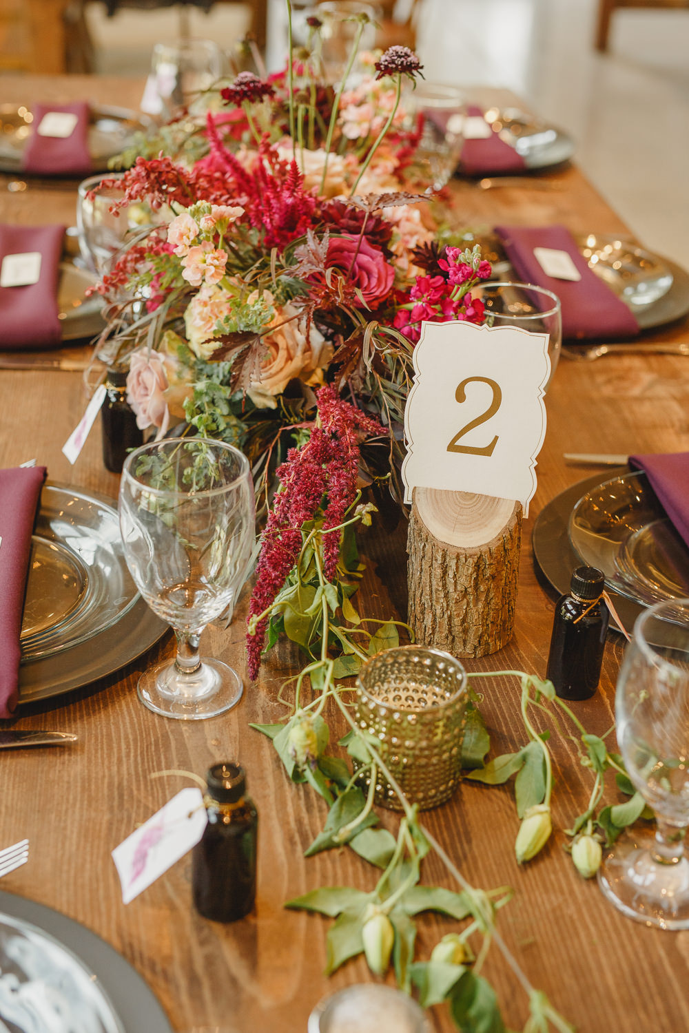Table Decor Tablescape Flowers Black Plates Red Napkins Candles Log Table Number Enchanted Forest Wedding Kristen Booth Photography