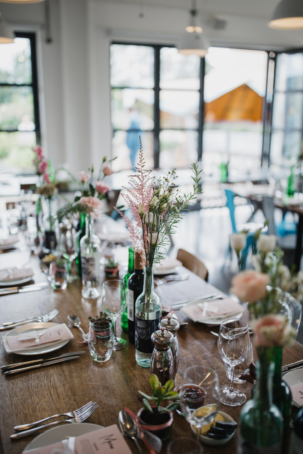 Wooden Table Bottle Flowers Pastel Decor Field Kitchen Wedding Siobhan Amy Photography