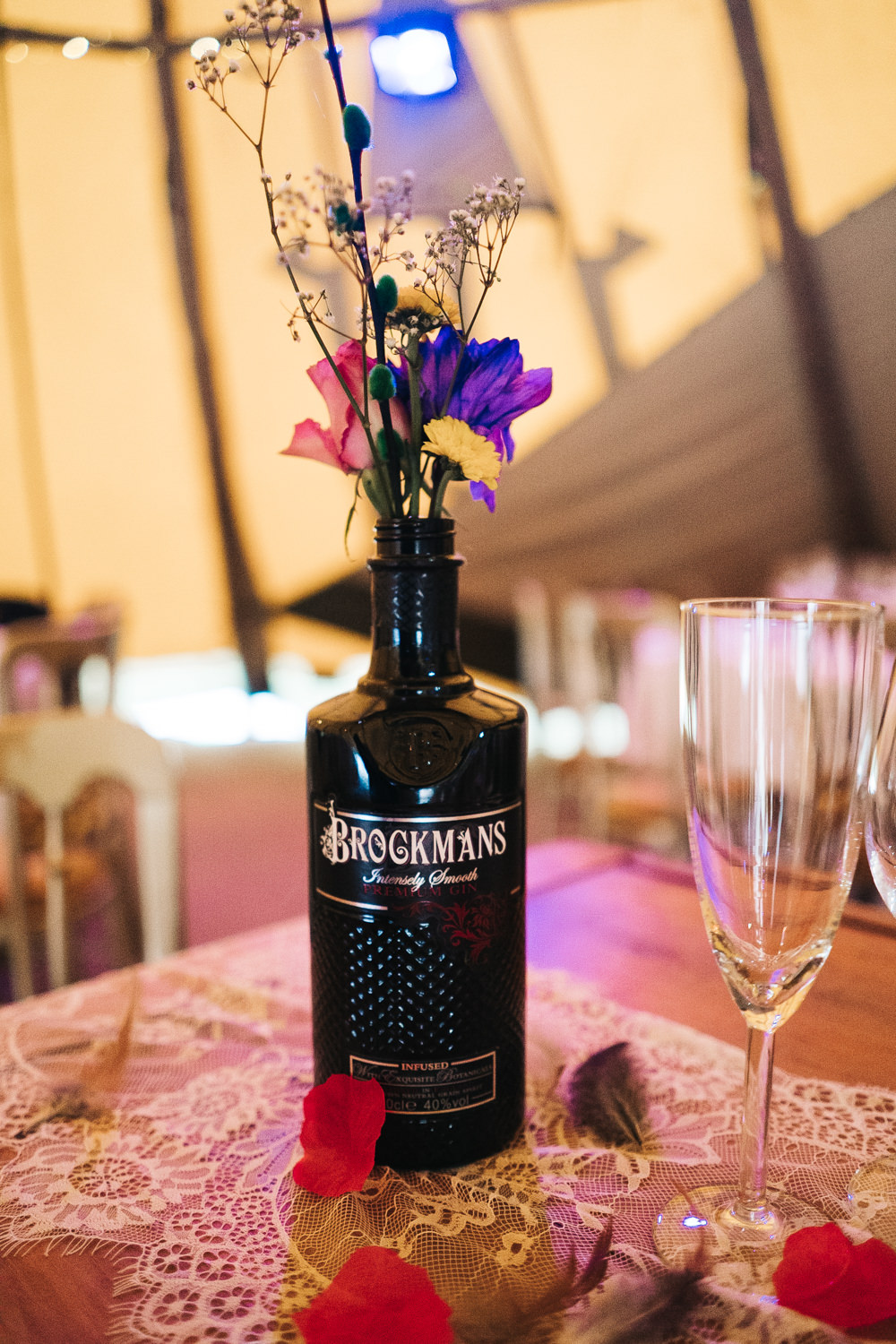 Tipi Long Wooden Tables Colourful Bottles Flowers Hammer and Pincers Wedding Sally T Photography