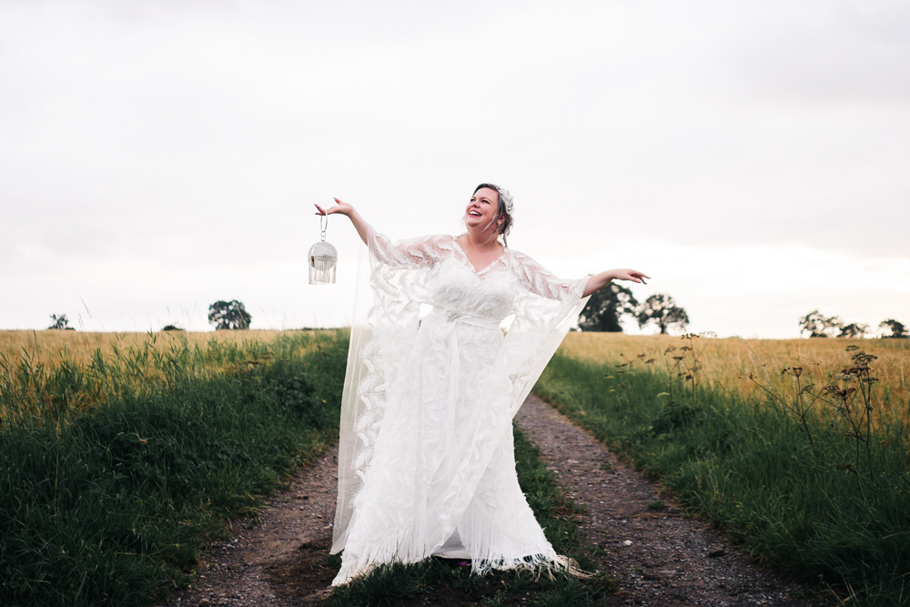Dress Gown Bride Bridal Butterfly Sleeves Feather Hammer and Pincers Wedding Sally T Photography