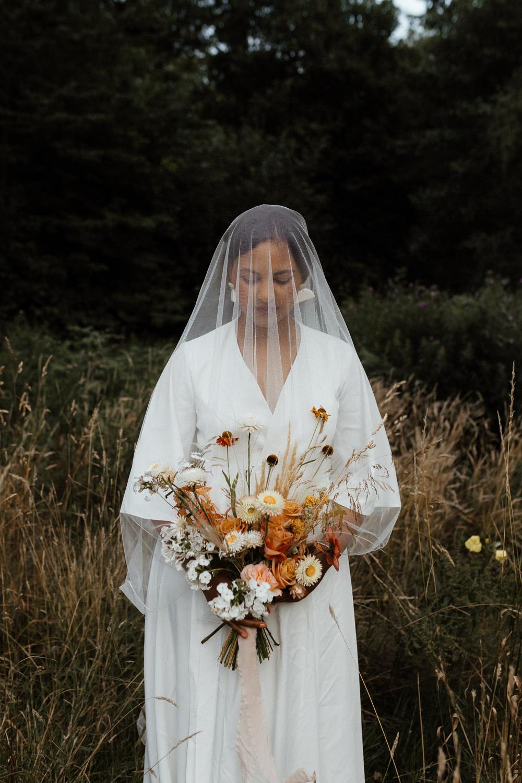 Small Wedding Ideas UK Caitlin and Jones Dress Gown Bride Bridal Boho Bohemian Bell Sleeves Veil Earrings