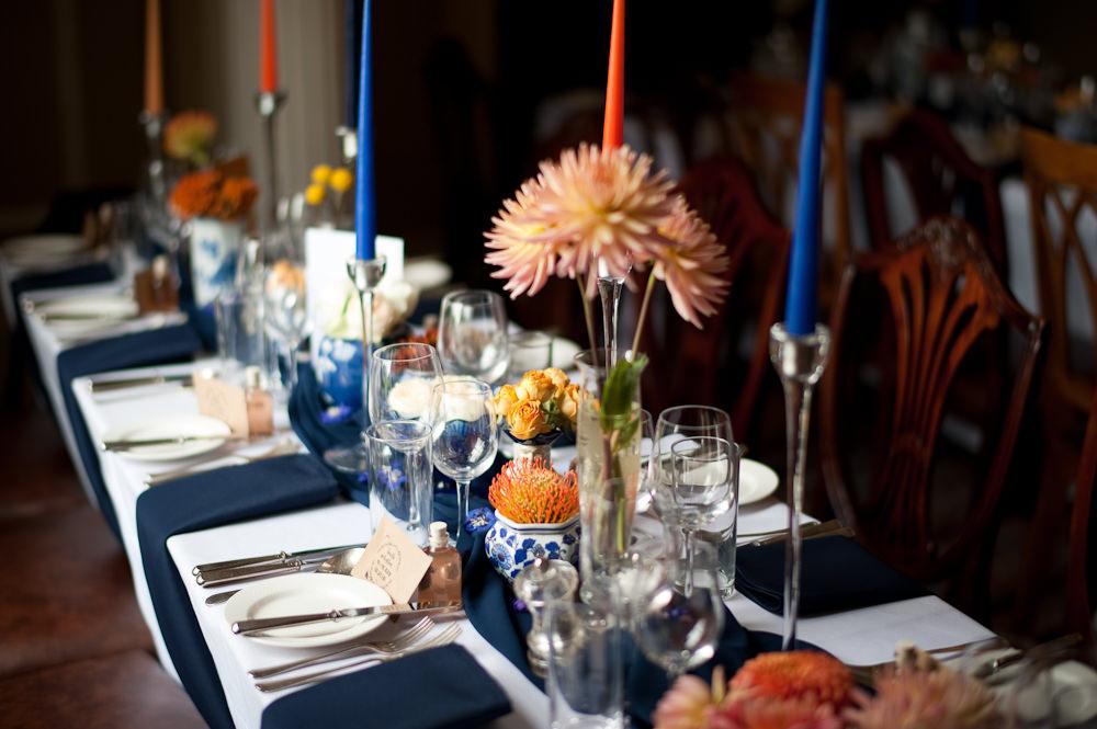 Coral Orange Dahlias Centrepiece Flowers Table Candles Blue Cloth Floral Wedding Rachael Connerton Photography