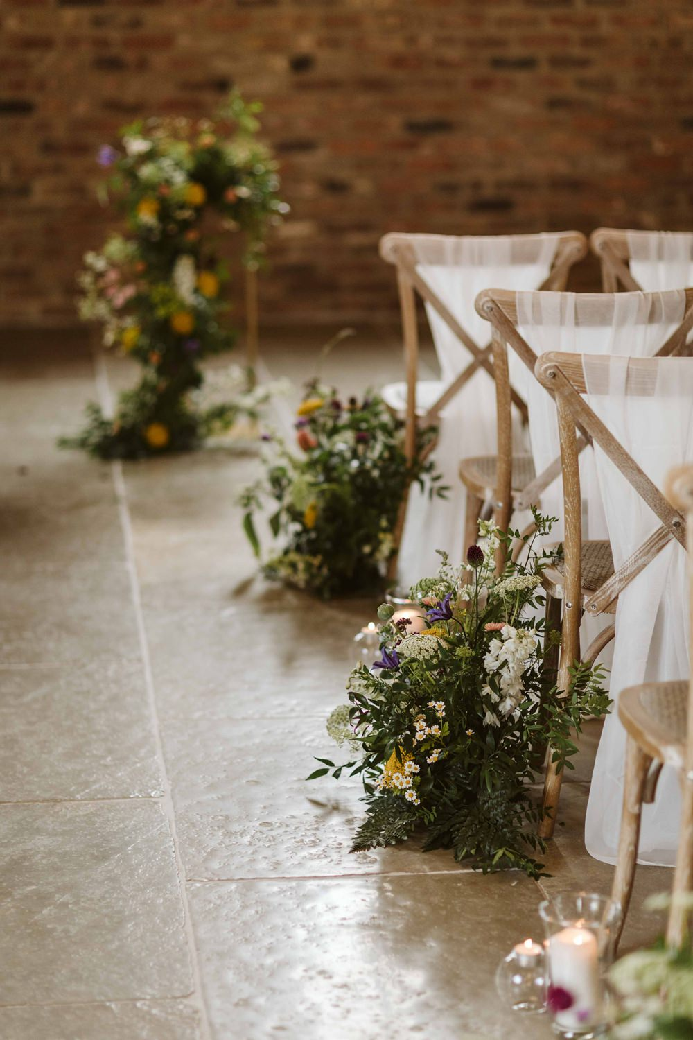 Oakwood at Ryther Wedding Freya Raby Chairs Aisle Pew End Flowers Candles Ceremony
