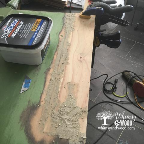 Damaged Desk seam patched with wood filler
