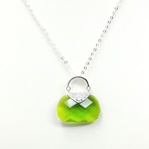 green purse necklace