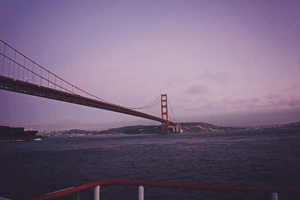 golden gate bridge in purple sunset